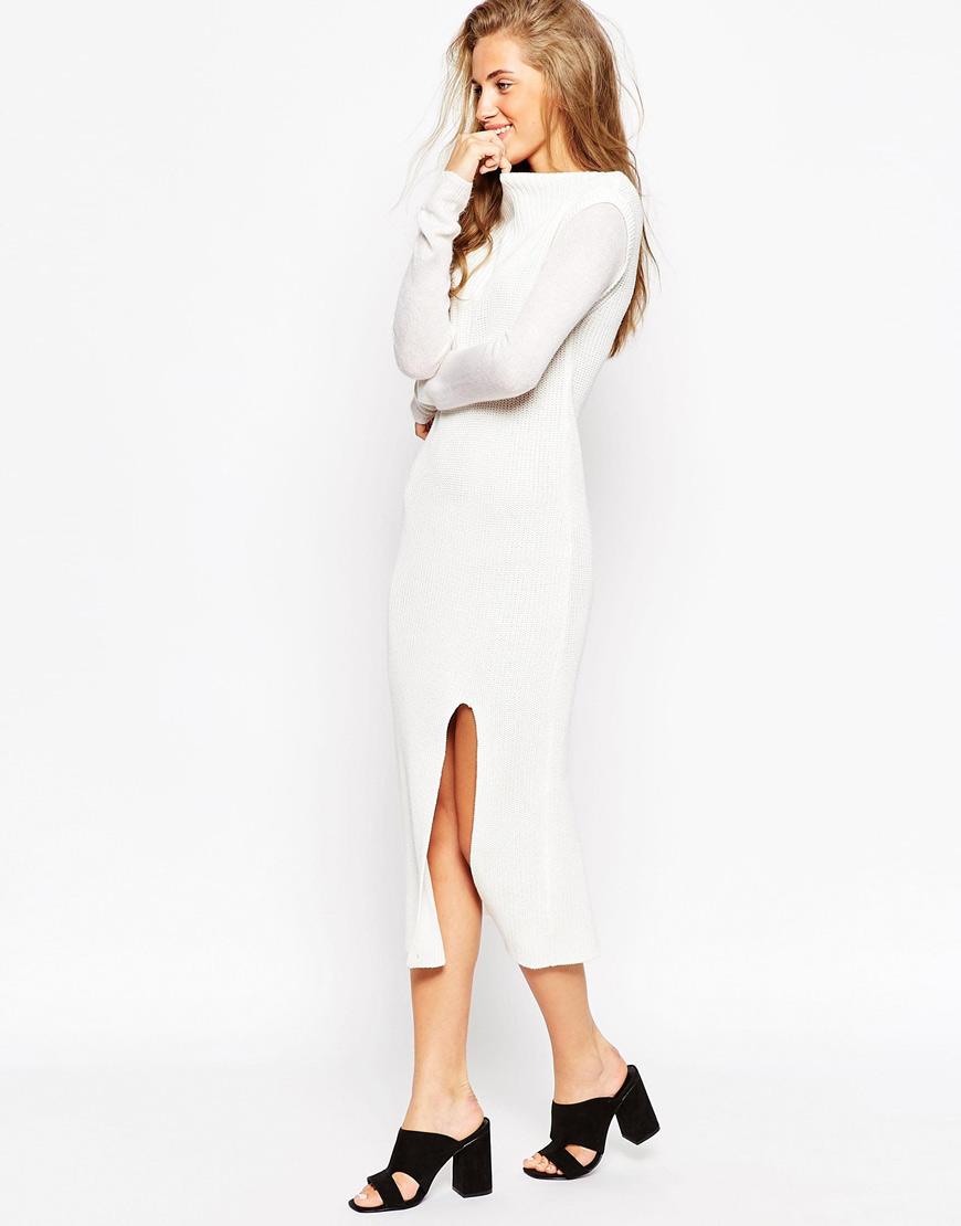 雪白的連身裙搭配小開釵 更是性感小心機